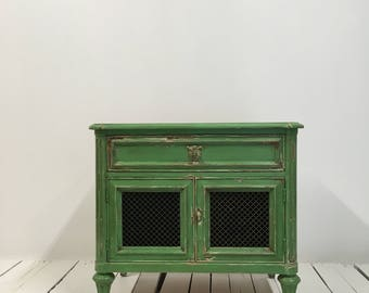 Hand painted and distressed wooden cabinet.