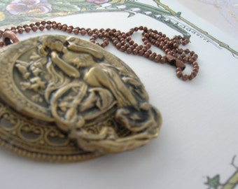 A bronze pendant with a beautiful lady