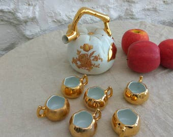 French vintage porcelain Calvados decanter and 6 cups. Fabulous kitsch apple shaped, gold decorated set.