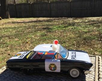 Vintage tin  police toy car, retro toy
