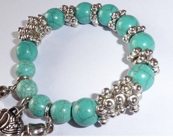 Torquoise Beaded Bracelet with Silver metal charms...