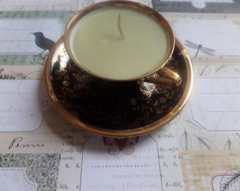 Green candle and black porcelain