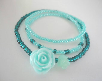 Wrap bracelet with 1 acrylic and 1 coral rose. Mint/turquoise