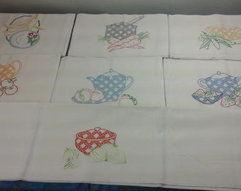 Set of seven vintage, four sack, embroidered kitchen dish towels.