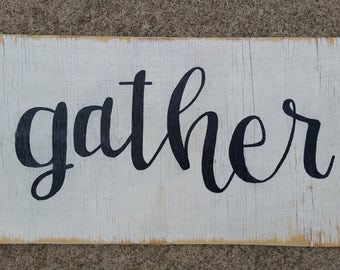 Hand painted, black and white Gather sign on reclaimed wood.
