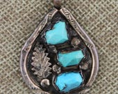 Navajo Sterling Silver Sleeping Beauty Turquoise Pendant, by Wayne Calavaza