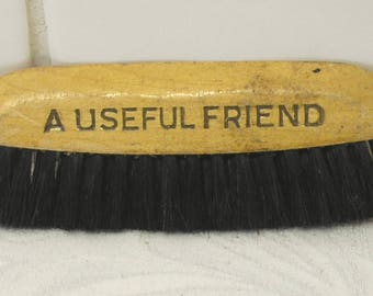 Vintage clothes brush A Useful Friend CWS For Everything Co-operative Wholesale Society advertising. Crumb brush Co-op advert clothing brush