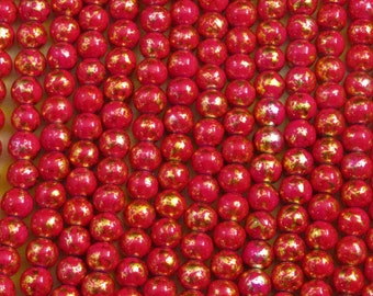 "8mm Gold-based and red ceramic beads that sometimes cast pink - 16"" / 8"" / 4"" strands - generous quantity discounts start @ 10 dollars!!!"