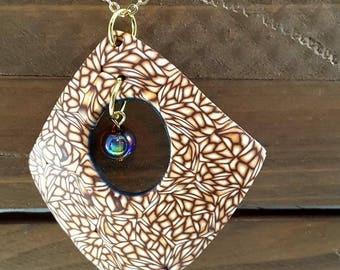 Polymer Clay lace design pendant with glass beads on gold chain