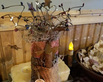 Primitive Americana bag with Spanish moss and pip berries with rusty stars and a handmade grungy candle.