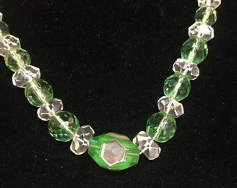 A necklace of the 1930s; rock crystal and green czech glass beads