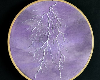 Lightning hand embroidery hoop art on hand painted watercolor fabric. 6 inch hoop.