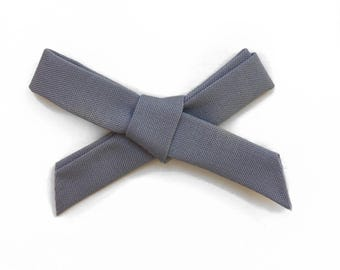 The Starlet Bow, Gray
