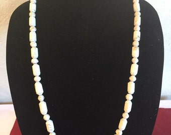 Handmade light tan colored paper bead necklace