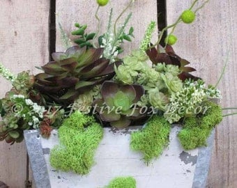 Succulent arrangement in a rustic wood box.