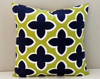 Navy blue and lime green quatrafoil indoor outdoor cushion cover