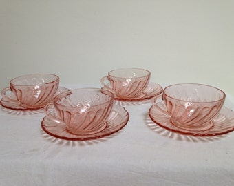 A set of 4 Arcoroc  Rosaline French Glass tea cups and saucers