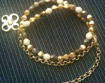 Cream, bronze and gold wrap bracelet.