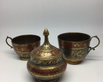Set of three enameled brassware