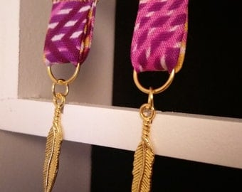 Wax and charms Gold feather earrings