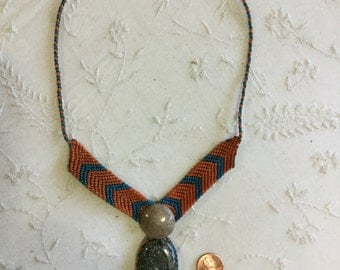 Tribal blue and orange knots