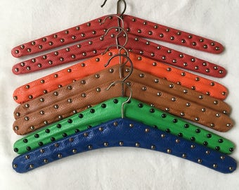 60 's vintage clothing pendants/charms for the coat rack. Imitation leather with studs.
