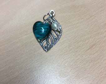 Silver leaf and turquoise heart pendant