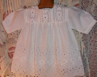 A pretty little old dress for child, baby doll