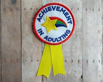 Achievement in Adulting Badge, Embroidered Canvas with Pin Back and Grosgrain Ribbon, Choice of Colors, Funny Gag Gift