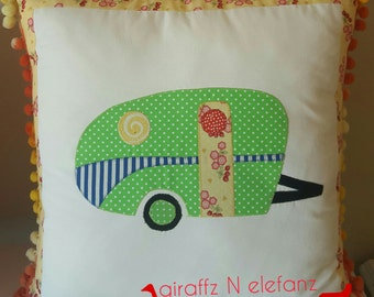 Green and yellow vintage caravan cushion