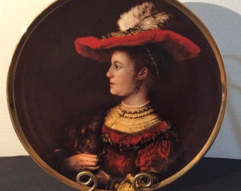 Mid century Rembrandt portrait in porcelain. Porcelain collectable plate featuring his first wife Saskia. Rembrant collectable.