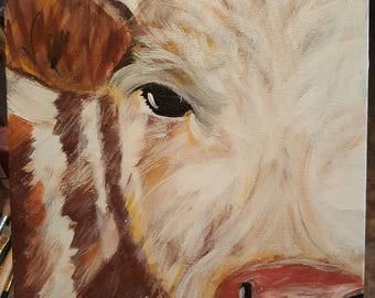 Brown and white cow painting