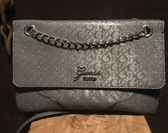 Guess gorgous clutch evening carry pirse with super shiny chain and leather carry strap