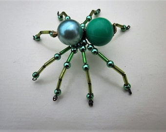 SPIDER BEADED.Green pearl,gold.