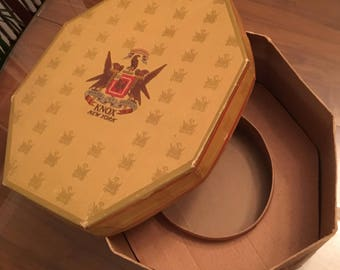 Vintage eight-sided hat box, Knox New York emblem, Registered, Moveo Et Proficio, gold with red stripes and crest