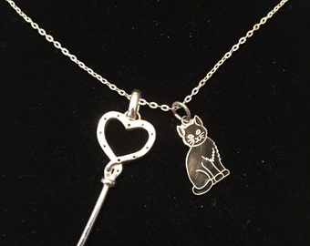 Vintage 925 sterling silver 23in.necklace and charm silver key and cat.