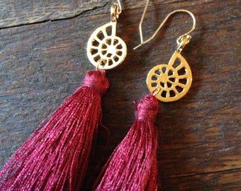 Nautilus long silk tassel earrings. Golden brass nautilus sea shell with a long burgundy silk tassel hang from a 14k gf French ear wire.