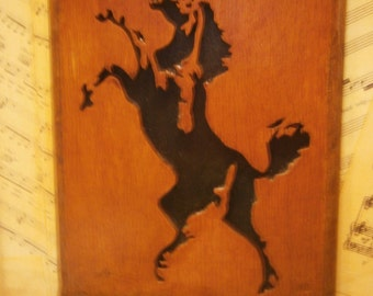 Wooden portrait of a rearing horse