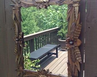 Ornate rusted steel leaf wall mirror
