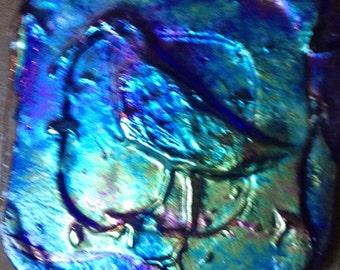 Iridescent blue glass bird tile
