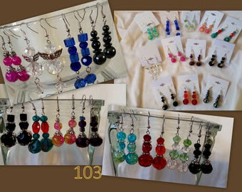 Set of 12 assorted handmade glass bead drop earrings that can be used for resale or personal use. Under 2.00 per pair.