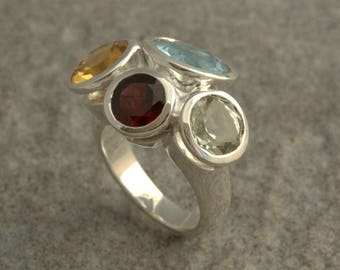 Sterling silver ring with faceted  differents stones