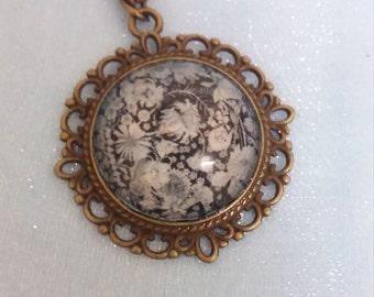 Black and white floral bronze pendant