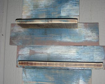 A shelve made of reclaimed wood and stained/painted to the color of your choice.