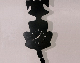 Dog clock with wagging tail.