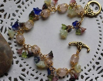 Green, purple, yellow, blue Czech glass flower bracelet, pale pink Czech glass beads, floral toggle clasp in gold, B017
