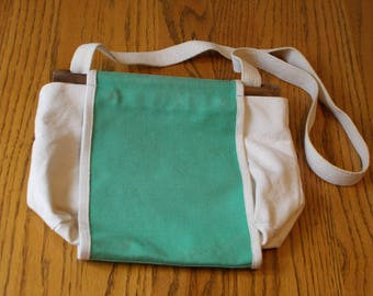 green and white canvas purse
