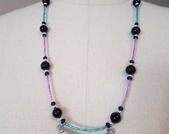 Dragonfly Necklace in blue and purple with sparkling accents.