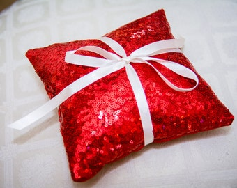 Red sequin ring pillow