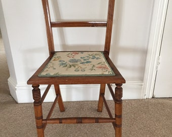 Occasional bedroom chair with upholstered seat